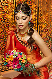 Oriental bride with bouquet