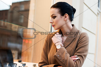 beautiful woman looking for sale in a winter day