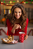 Woman having a cup of hot chocolate and Christmas sweets