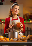 housewife making homemade orange marmalade in Christmas kitchen