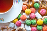 Cup of tea with candy