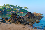 old boat in the rocks at the beach of Goa