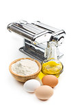 ingredients for preparing pasta and pasta machine