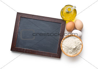 chalkboard and ingredients for preparing pasta