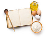 cookbook and ingredients for preparing pasta