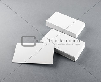 Blank business cards on gray