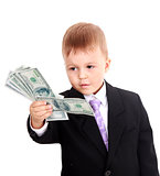 Portrait of a cheerful little boy holding a dollars