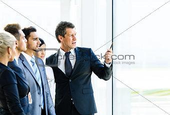 Business seminar where a boss explaining
