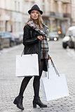 urban girl going for shop in winter sale