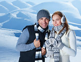 Beautiful couple in winter mountains