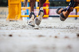 view of horse hooves at jumping competition training
