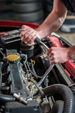 Car mechanic in auto repair service, starting ignition plug