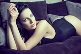 stunning woman lying on sofa