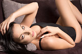 glamour woman relaxing on sofa