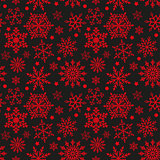 Snowflakes on black and red background seamless texture