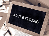 Hand Drawn Advertising Concept on Small Chalkboard.