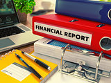 Red Office Folder with Inscription Financial Report.
