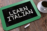 Learn Italian - Chalkboard with Hand Drawn Text.