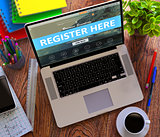 Register Here Concept on Modern Laptop Screen.