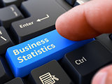 Business Statistics - Concept on Blue Keyboard Button.