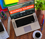 Business Tourism Concept on Modern Laptop Screen.