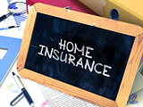 Home Insurance Handwritten on Chalkboard.