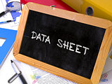 Data Sheet Handwritten on Chalkboard.