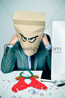 man in his office with a paper bag in his head in christmas