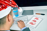 man with a tablet with text ho ho ho in his office