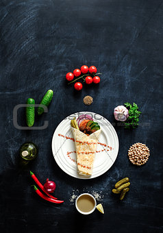 Falafel on a white plate.