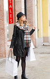 cute sweet woman in winter day for shopping