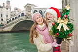 Mother and child in Santa Hat with Christmas tree in Venice