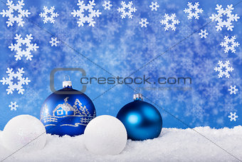 Blue Christmas balls in the snow