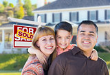 Young Family in Front of Sold Real Estate Sign and House
