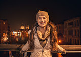 Portrait of woman standing on a bridge overlooking Grand canal