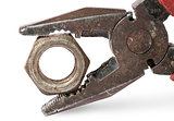 Closeup of old pliers and nut