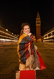 Woman in winter coat with shopping bags on Piazza San Marco