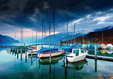 Boats and yachts on lake Thun at night.