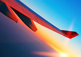 Air travel at sunrise