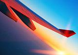 Air travel at sunrise