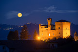 Castle of Grinzane Cavour in nocturnal with a full moon