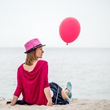 Happy girl holding air balloon