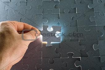 Man holding puzzle piece