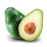 Whole and half avocado