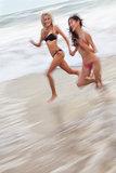 Motion Blur Girls Women Running on Beach