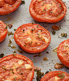 Roast tomatoes, seasoned with thyme and garlic
