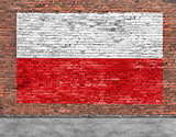 Polish flag painted on brick wall