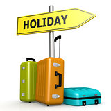 Luggages with holiday road sign
