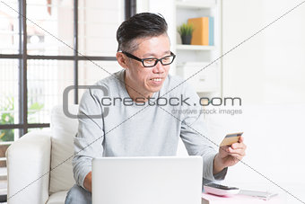 Asian man making online payment