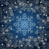 Christmas card with golden snowflakes on dark blue background.